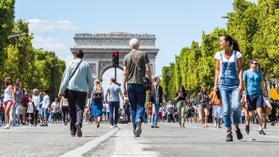 People walking on the famous French boulevard Champs Elysees closed for car traffic.