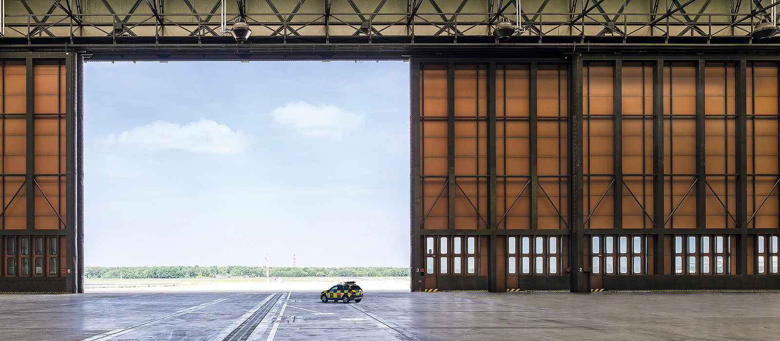 Hangar, view from the inside through the open gate